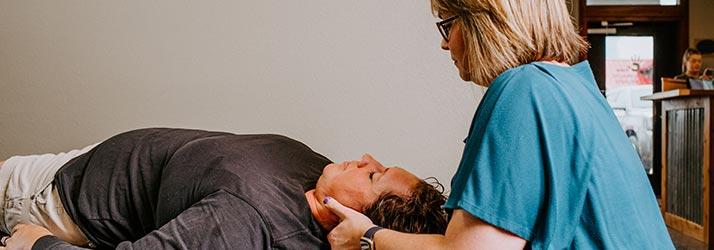 Chiropractor Salado TX Dr. Allyn Crain Adjusting Patient