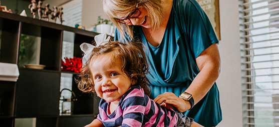 Chiropractor Salado TX Dr. Allyn Crain Adjusting Pediatric Patient